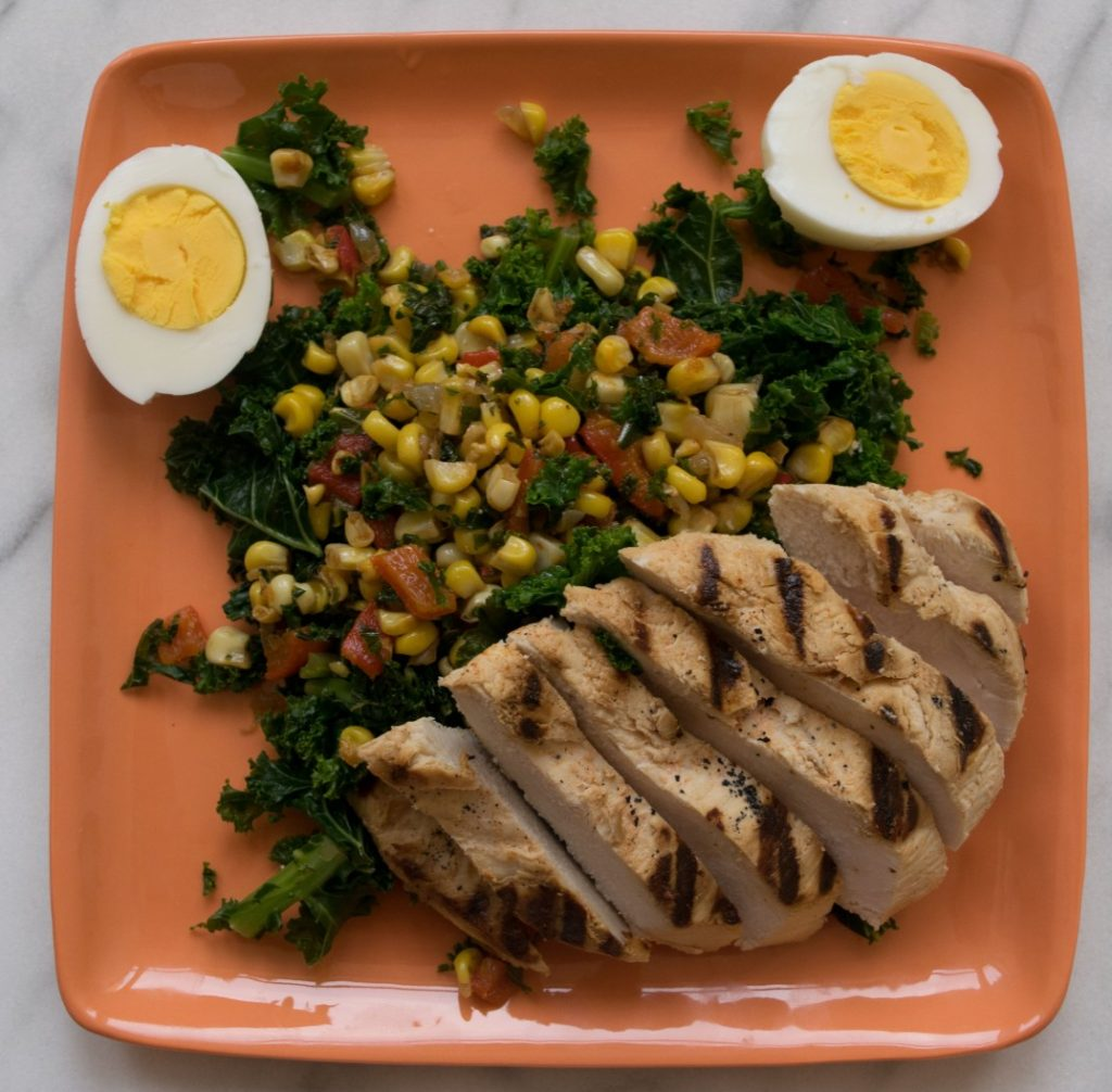 Grilled Chicken with Cooked Kale and Corn Salad Fete-a-Tete